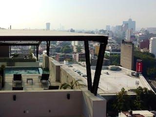 Una vista de una ciudad con un puente en el fondo en GRANDIOSO departamento en venta con 3 recámaras, alberca, balcón- Roma Norte