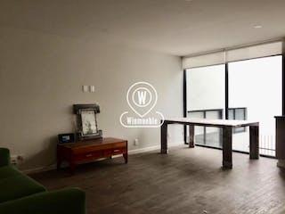 Una sala de estar llena de muebles y un reloj en Departamento en Venta en Juarez Cuauhtémoc