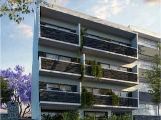 Un edificio alto con muchas ventanas en Departamento en venta en Narvarte de 104m²