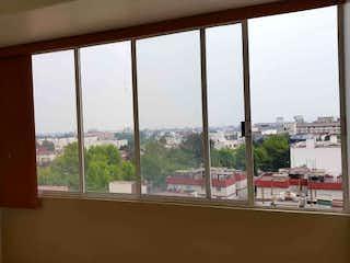 Una ventana con una vista de la ciudad en Departamento en venta en Santa Cruz Atoyac 71m²