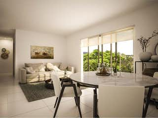 Una sala de estar llena de muebles y una mesa en Departamento en venta en Portales de 65m²