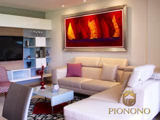 Una sala de estar llena de muebles y una televisión de pantalla plana en Pionono Art