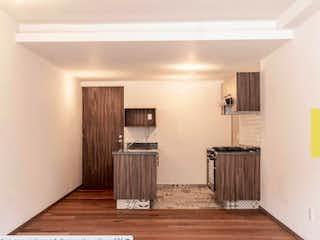 Una cocina con suelos de madera y armarios de madera en Departamento en venta en Tabacalera 72m²