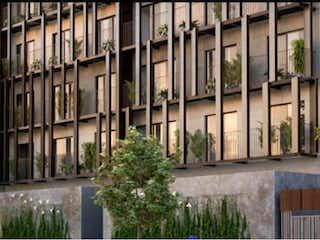 Un banco de madera delante de un edificio en Departamento en venta en Colonia Cuauhtémoc 73m²