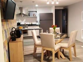 Una sala de estar llena de muebles y un perro en Departamento en venta en Anáhuac de 59m²