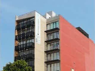 Un edificio de ladrillo rojo con un edificio de ladrillo rojo en Departamento en venta en Santa María Nonoalco de 2 hab.