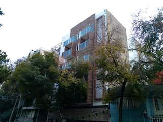 Un edificio de ladrillo alto con un reloj en él en Departamento en venta en Portales con Piscina...