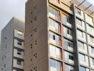 Un edificio alto sentado al lado de una calle en Departamento en venta en Juárez de 2 alcobas