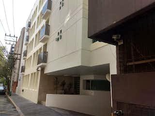 Un edificio blanco con un reloj en el costado en Departamento en venta en Insurgentes Mixcoac, 380m² con Bbq...