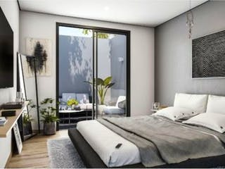 Una habitación de hotel con dos camas y una gran ventana en Departamento en venta en Letrán Valle de 1 recámara
