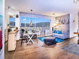 Una sala de estar llena de muebles y una ventana en Jazz