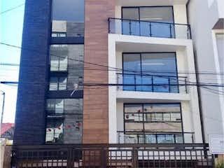 Un edificio con un reloj en el costado en Departamento en venta en Narvarte 104m²
