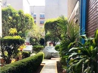 Una vista de una calle en una ciudad en Departamento en Venta en Tlalcoligia Tlalpan