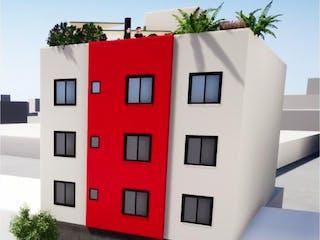 Un edificio rojo y blanco con una planta en él en Departamento en venta en 7 De Noviembre con Bbq...