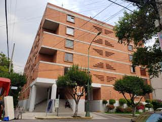 Un edificio de ladrillo alto con un reloj en él en Departamento en Venta en Narvarte Poniente Benito Juárez
