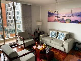 Una sala de estar llena de muebles y una gran ventana en VENTA DE APARTAMENTO MODELIA (FONTIBON)