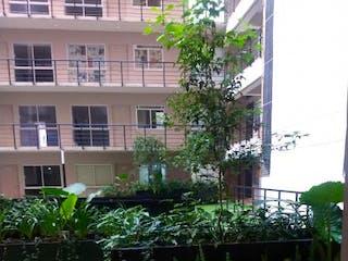 Una planta está creciendo fuera de un edificio en Departamento en Venta en Granjas Mexico Iztacalco