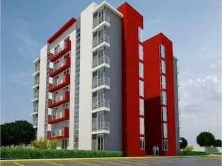 Un edificio alto con una bandera roja en él en Departamento en Venta en Zacatenco Lindavista Gustavo A. Madero