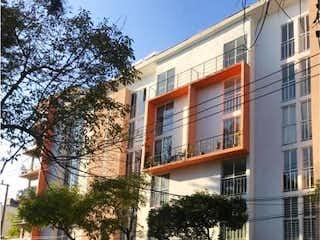 Un coche estacionado delante de un edificio en Departamento en Venta en Popular Rastro Venustiano Carranza