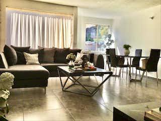 Una sala de estar llena de muebles y una mesa de café en Departamento en Venta en Lomas de San Angel Inn Álvaro Obregón