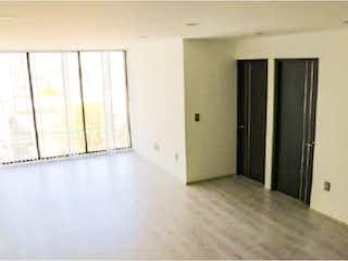 Un pasillo que conduce a un pasillo con una puerta en Departamento en Venta en Moctezuma 2a Sección Venustiano Carranza