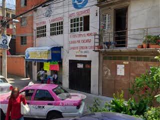 Un coche estacionado delante de un edificio en Casa en venta en Doctores de 232m²