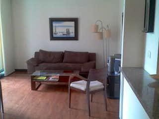 Una sala de estar llena de muebles y un suelo de madera en Apartamento En Venta En Bogota Modelia