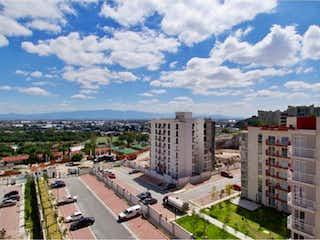 Una vista de una ciudad en la distancia en Departamento en Venta en Zacatenco Lindavista Gustavo A. Madero