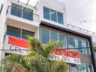 Un edificio que tiene una señal en él en Departamento en Venta en Miguel Hidalgo 3A Sección Tlalpan