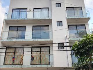 Un edificio con un reloj en el costado en Departamento en Venta en Pedregal de Santa Úrsula Coyoacán