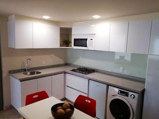 Una cocina con un fregadero y un horno de cocina en Departamento en venta en El Yaqui 43m² con Bbq...