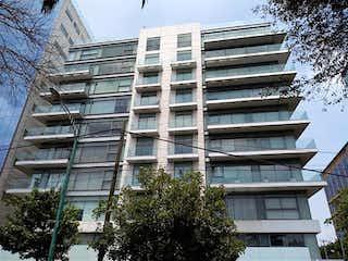 Un edificio alto con muchas ventanas en Departamento en Venta en Lomas de Chapultepec III Sección Miguel Hidalgo