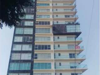 Un edificio alto sentado al lado de un edificio amarillo en Departamento en venta en San ángel 75m² con Gimnasio...