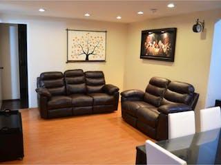 Una sala de estar llena de muebles y una televisión de pantalla plana en Departamento en Venta en Reforma Social Miguel Hidalgo