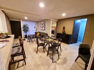 Una sala de estar llena de muebles y una televisión de pantalla plana en Departamento en venta en Bondojito de 2 alcobas