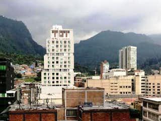 Una vista de una ciudad con edificios altos en el fondo en Bogota, Apartamento en venta en Las Nieves 42m² con Zonas húmedas...