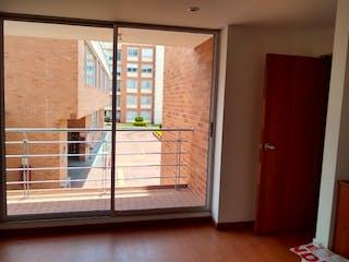 Un gato está mirando por la ventana en Apartamento en venta en Casco Urbano Cajicá con acceso a Gimnasio