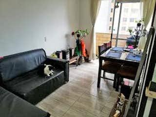 Una sala de estar llena de muebles y una chimenea en Apartamento en venta en Pajarito, de 47mtrs2