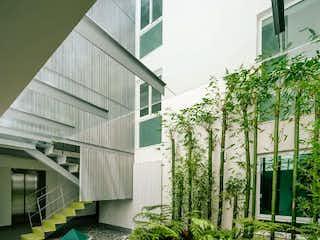 Una vista de un jardín con un edificio en el fondo en Últimos Departamentos en Del Valle Centro