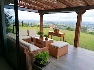 Una sala de estar llena de muebles y una gran ventana en INCREDIBLE COUNTRY HOUSE W/ 120,000 FT2 LOT
