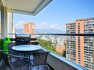 Una vista del horizonte de la ciudad desde una ventana en CLASSIC APARTMENT NEAR SANTAFE MALL WITH GORGEOUS CITY VIEWS