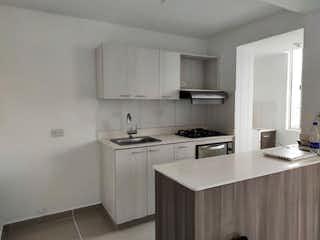 Una cocina con una estufa de fregadero y armarios en Apartamento en Venta LAS BRISAS