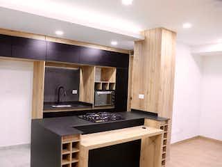 Una cocina con lavabo y microondas en Apartamento en venta en Amazonía de tres habitaciones