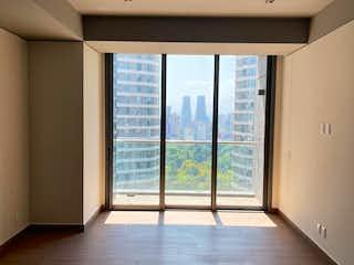 Una vista de una habitación con una puerta corredera de cristal en Departamento Nuevo en B.G. Polanco