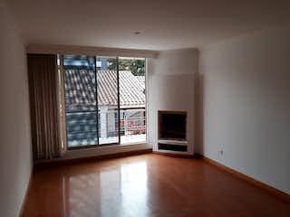 Una vista de una sala de estar con un gran ventanal en Venta Apartamento en Santa Barbara Central