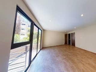 Un dormitorio con una cama y un gran ventanal en Departamento en venta de 75 mts, en Portales de 2 recàmaras