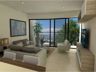Una sala de estar llena de muebles y una televisión de pantalla plana en Departamento en venta en Nápoles de 81m²