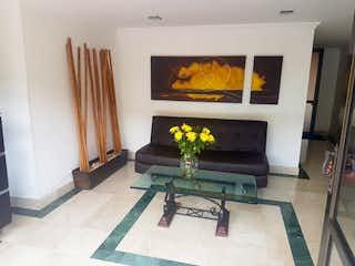 Una sala de estar llena de muebles y una chimenea en Apartamento en Venta COLINA CAMPESTRE