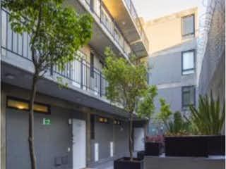 Una vista de una casa en una ciudad en Departamento en venta en Santa María La Ribera con acceso a Jardín