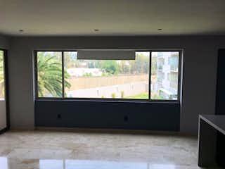 Una gran televisión de pantalla plana montada en una pared en Departamento en Venta en San Jeronimo Lidice La Magdalena Contreras